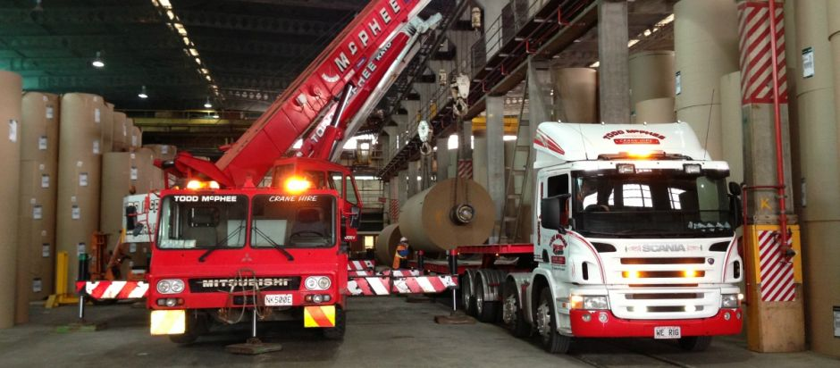 Todd McPhee Crane Hire 50T and Scania Transporter loading paper roll at Kinleith.